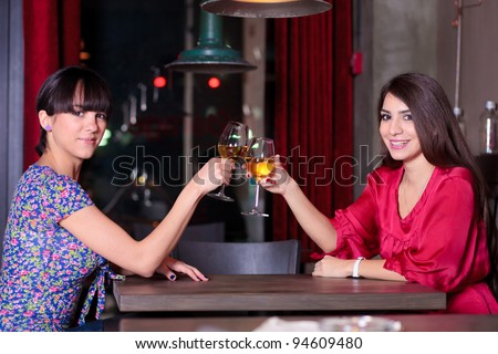 two girls toasting