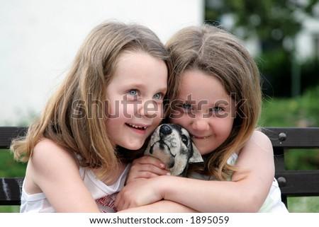 Two girls - twins - stock photo