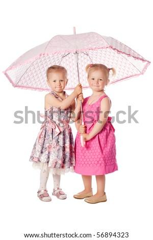 two girls under umbrella - stock photo