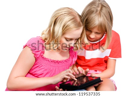 two girls using tablet isolated over white background - stock photo