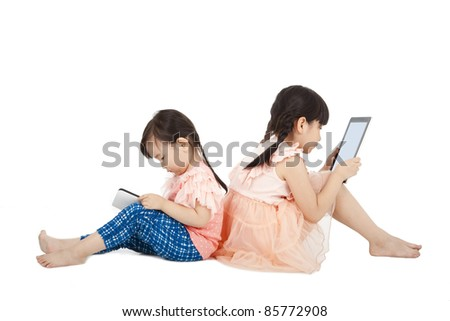 Two girls using touchscreen tablet PC - stock photo
