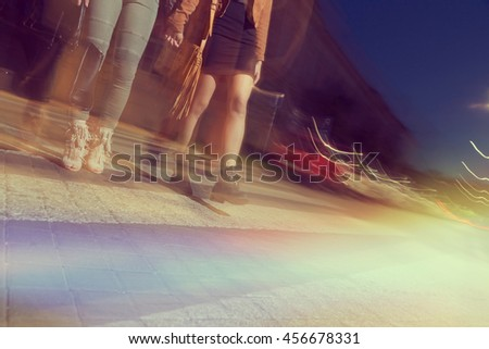 Two girls walking down the city streets, ready for a night out with friends
