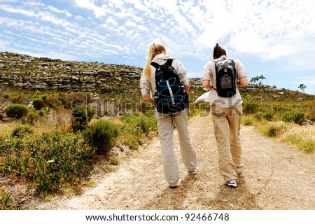 two girls walking outdoors and having fun exploring the wilderness