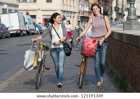 Two Girls while They Make a Shopping - stock photo