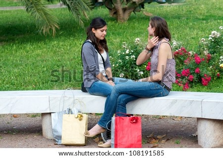 Two Girls While They Make a Shopping and Photographer - stock photo