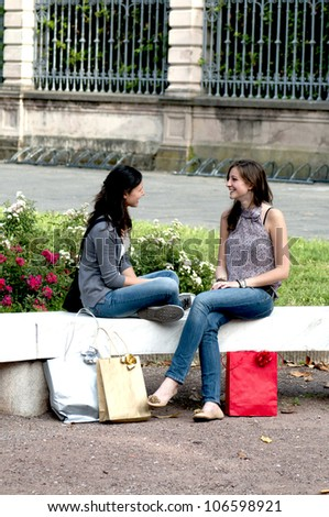 Two Girls While They Speak after to Have Made a Shopping - stock photo