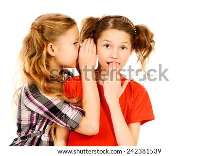 Two girls whispering to each other about something. Isolated over white. - stock photo