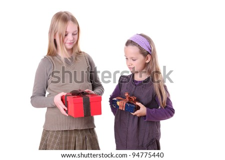 Two girls with a present/sisters/ - stock photo