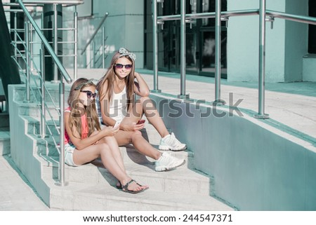 two girls with a telephone - stock photo