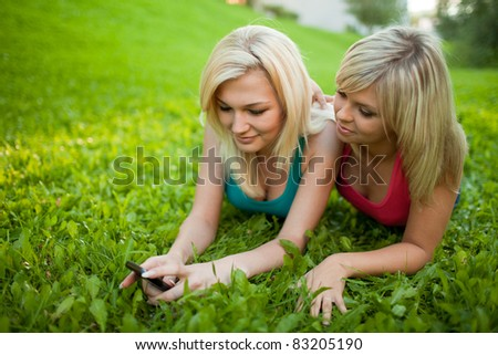 Two girls with cell phone
