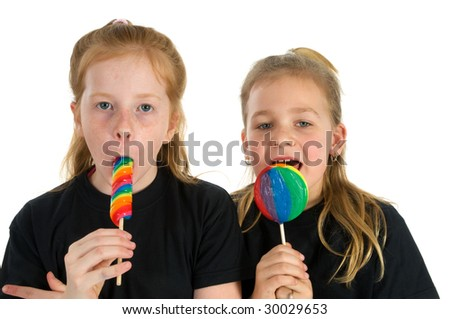 Two girls with colored lollipop - stock photo