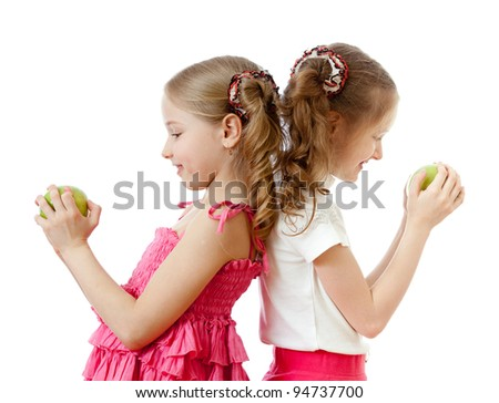 two girls with green apple healthy food - stock photo