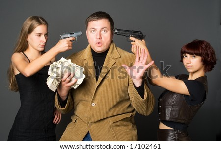 Two girls with guns and gangster with money. - stock photo