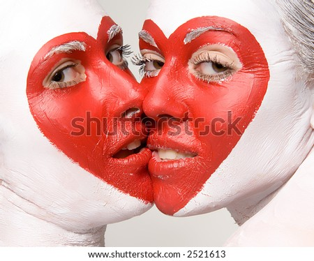 Two girls with painted faces delivering red heart pattern