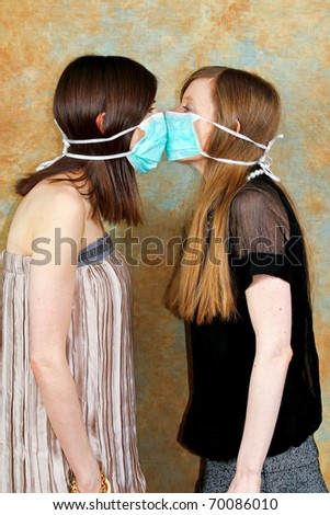 Two girls with protective masks against each other - stock photo