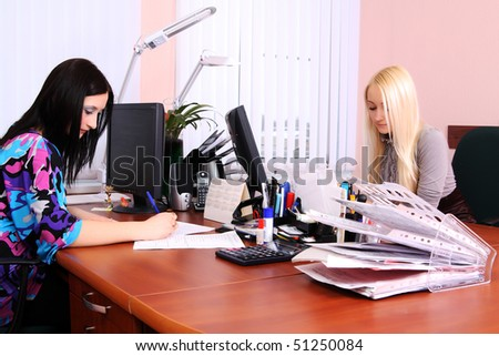 Two girls working in the office