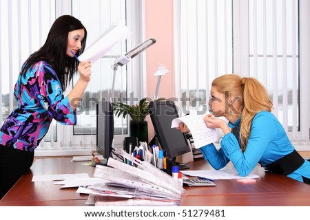 Two girls working in the office - stock photo
