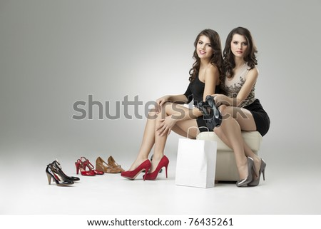 two glamorous women shopping high heels