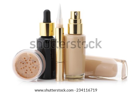 Two glass bottle of liquid foundation, corrective concealer, loose mineral powder and face serum isolated on white background.