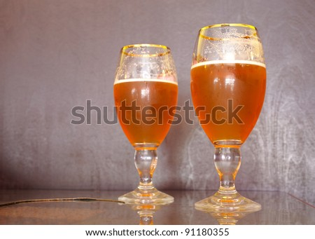 Two glass of fresh beer - stock photo