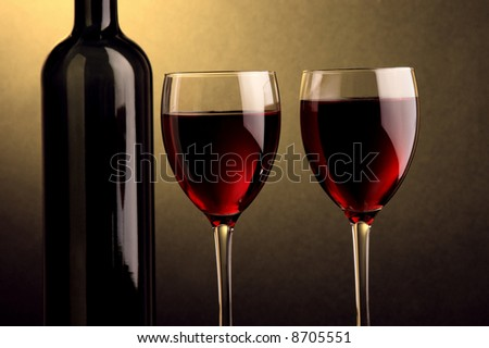 two glass of red wine and a bottle