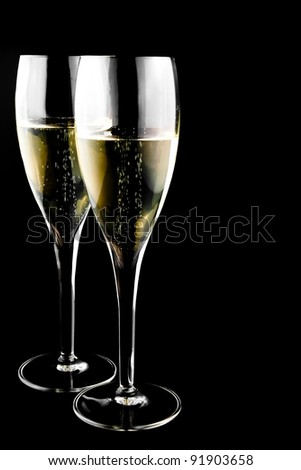 two glass with champagne on a black background