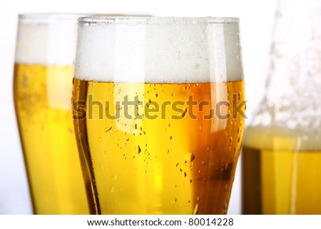 Two glasses and Bottle of fresh light beer - stock photo