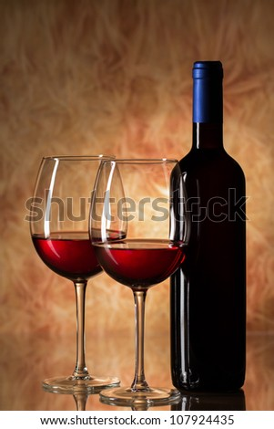 Two glasses and bottle of red wine - stock photo