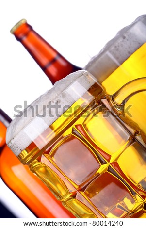 Two glasses and Bottles of fresh light beer - stock photo