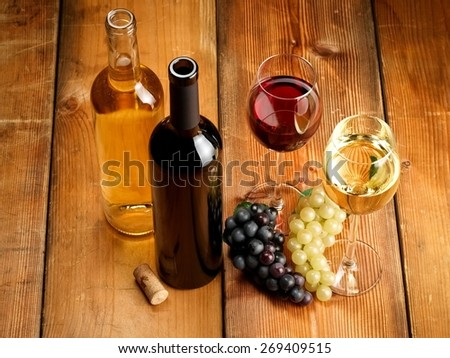 Two glasses and bottles with red and white wine, top view - stock photo