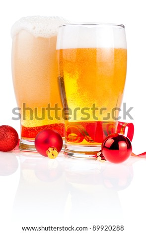 Two glasses fresh lager beer, Red ribbon and Christmas Balls isolated on white background - stock photo