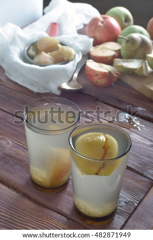 two glasses of apple juice (compote) and sliced apples