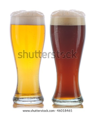 Two Glasses of Beer a Pilsner and a Dark Ale with Reflection isolated on white - stock photo