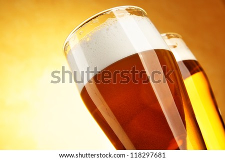 Two glasses of beer close-up - stock photo