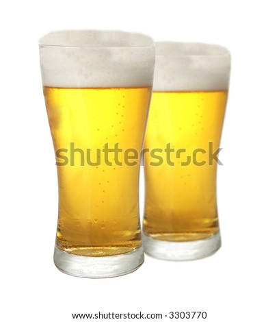 Two glasses of beer isolated on white background - stock photo