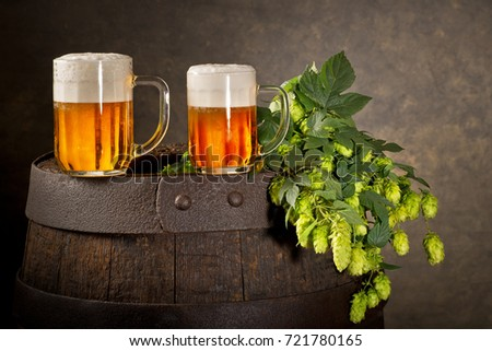 Two Glasses of Beer with Hop Cones