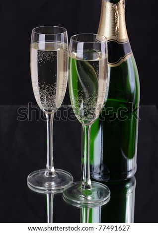 Two glasses of champagne and bottle - stock photo