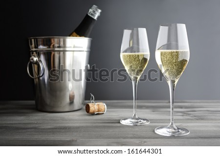 Two glasses of Champagne and Cooler - stock photo