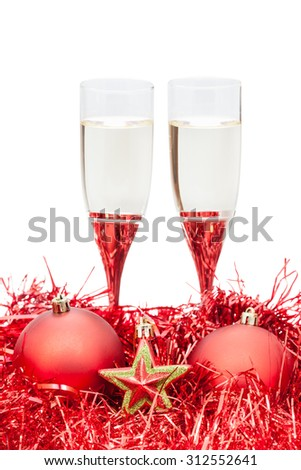 two glasses of champagne and star at red Christmas decorations isolated on white background