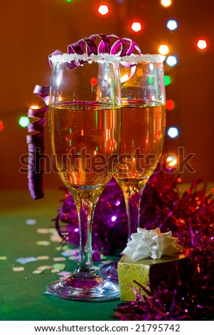 Two glasses of champagne. Christmas lights and confetti. - stock photo