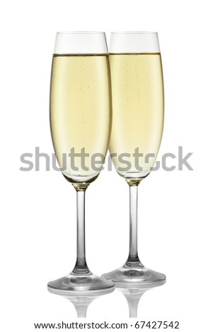 Two glasses of champagne isolated on the white background, clipping path included. - stock photo