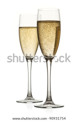 Two glasses of champagne. Isolated on white background - stock photo
