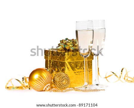 two glasses of champagne on a white background with a gift and decorations