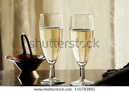 Two glasses of champagne on abstract yellow background - stock photo