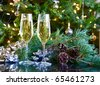 two glasses of champagne on green christmas background - stock photo