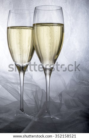 Two Glasses of Champagne on Grey Background - stock photo