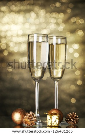 two glasses of champagne on shine background - stock photo