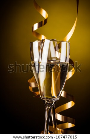 Two glasses of champagne on yellow background - stock photo