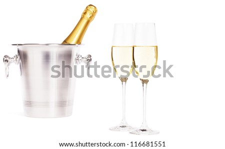 two glasses of champagne with a champagne bottle in a bucket on white background - stock photo