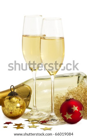 two glasses of champagne with angels hair, metal stars, red and golden christmas balls in front of a champagne bottle on white background - stock photo